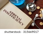 Small photo of Adrenal insufficiency written on book with tablets. Medicine concept.