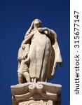 Small photo of BJELOVAR, CROATIA - SEPTEMBER 06: Saint Teresa of Avila statue in front of the Cathedral of St. Teresa of Avila in Bjelovar, Croatia on September 06, 2013