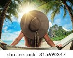 beautiful woman with straw hat... | Shutterstock . vector #315690347