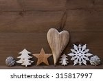 Small photo of Wooden Background With Many Christmas Decoration.Heart, Snowfalke, Fir Cone, Christmas Tree, Star. Copy Space, Free Text Or Your Text Here. Rustic Or Vintage Style