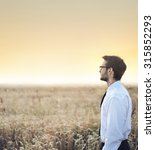 businessman on a meadow at...   Shutterstock . vector #315852293