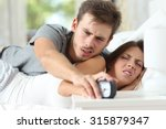 sleepy angry couple in the bed... | Shutterstock . vector #315879347