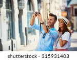 tourists taking photo in the... | Shutterstock . vector #315931403
