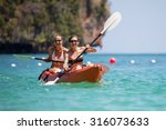 Caucasian Woman Is Kayaking In...