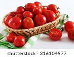 fresh red tomatoes in basket on ... | Shutterstock . vector #316104977