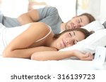 happy couple sleeping in a... | Shutterstock . vector #316139723