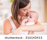 mother and baby are kissing and ... | Shutterstock . vector #316143413