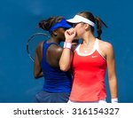 Small photo of STANFORD, UNITED STATES - AUGUST 4 : Ajla Tomljanovic and Asia Muhammad talk strategy during their 2015 Bank of the West Classic WTA Premier tennis tournament doubles match