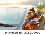 smiling woman driving a car at... | Shutterstock . vector #316204907
