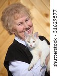 Smiling Aged Woman With Cat On...