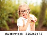 funny kid girl eating sandwich... | Shutterstock . vector #316369673