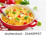 Small photo of Gluten-free pasta with tomato sauce and cheese.