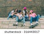 skateboarder friends on the... | Shutterstock . vector #316443017