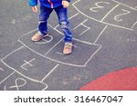 kid playing hopscotch on... | Shutterstock . vector #316467047
