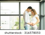 happy and young pregnant couple ... | Shutterstock . vector #316578053