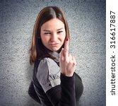 young girl making horn gesture... | Shutterstock . vector #316617887