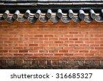 A Brick Wall Of A Korean...