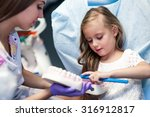 dentist curing a child patient... | Shutterstock . vector #316912817