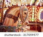 merry go round wooden horses... | Shutterstock . vector #317059577