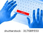 "Small photo of Hands on laptop with ""ADWARE"" word on spacebar button on white background."