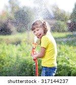 Cheerful Kid Girl Watering...