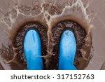 Blue Wellies Splashing In Mud...