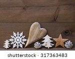 Small photo of Wooden Background With Many Christmas Decoration.Heart, Snowfalke, Fir Cone, Star, Christmas Tree. Copy Space, Free Text Or Your Text Here. Rustic Or Vintage Style