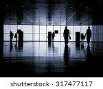 three business people walking... | Shutterstock . vector #317477117