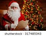 Senior Man In Costume Of Santa...