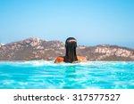 beauty woman in pool | Shutterstock . vector #317577527