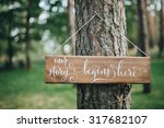 A Wooden Plaque With The...