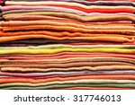 pile of folded colorful scarfs... | Shutterstock . vector #317746013