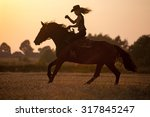 silhouette of a riding cowgirl. | Shutterstock . vector #317845247