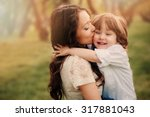 happy loving young mother... | Shutterstock . vector #317881043