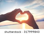 Heart Shape Made With Hands At...