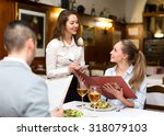 hospitable waitress taking an... | Shutterstock . vector #318079103