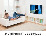 young man watching movie on... | Shutterstock . vector #318184223