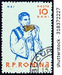 """Small photo of ROMANIA - CIRCA 1961: A stamp printed in Romania from the """"Musicians """" issue shows Pan flute player, circa 1961."""