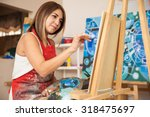 focused young female artist...   Shutterstock . vector #318475697