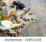 goat cheese and honey on wooden ...   Shutterstock . vector #318511103