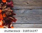 Fall Leaves On Rustic Wooden...