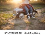 little racer and tiny race car | Shutterstock . vector #318522617