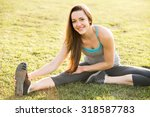 young woman outside stretching... | Shutterstock . vector #318587783