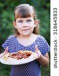 little girl holding a dessert... | Shutterstock . vector #318645833