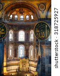 Small photo of ISTANBUL, TURKEY - JULY 9, 2014: The interior of the Hagia Sophia with with Islamic elements: minbar and mihrab and medallions with the names of Muhammad and Allah on the top of the main dome