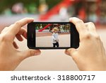 woman taking a photo of baby... | Shutterstock . vector #318800717