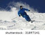 Skier Moving Down On Ski Slope...