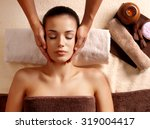 masseur doing massage on woman... | Shutterstock . vector #319004417