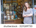 portrait of female bookshop... | Shutterstock . vector #319189733