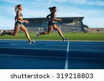 athletes arrives at finish line ... | Shutterstock . vector #319218803